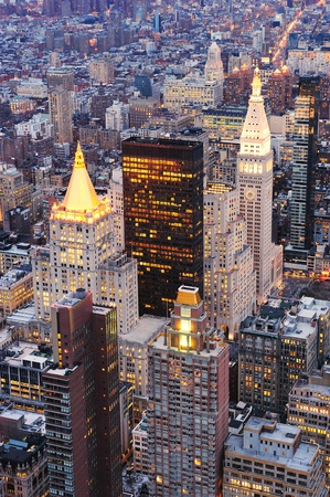 penthouse: New York City Manhattan downtown aerial view at dusk with urban city skyline and skyscrapers buildings