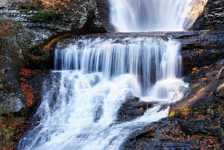 Waterfall in Autumn mountain with woods, foliage and rocks. From Digmans Fall of Pennsylvania Stock Photo - 9365927