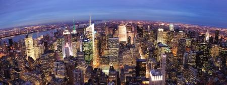 times square: New York City Manhattan Times Square night city skyline aerial view with urban skyscraper illuminated.