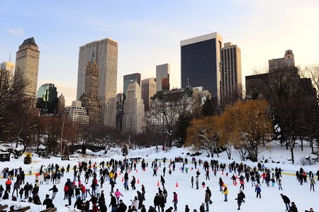 NEW YORK CITY, NY - JAN 1: People skate on ice with white Christmas in Central Park welcome the new year of 2010 on January 1, 2011 in Manhattan, New York City. Stock Photo - 9444838