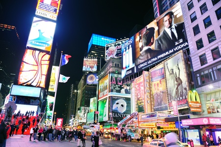 NEW YORK CITY, NY - JAN 30: Times Square is featured with Broadway Theaters and LED signs as a symbol of New York City and the United States. January 30, 2011 in Manhattan, New York City.  Stock Photo - 9444812