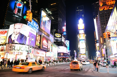 NEW YORK CITY, NY - JAN 30: Times Square is featured with Broadway Theaters and LED signs as a symbol of New York City and the United States. January 30, 2011 in Manhattan, New York City.  Stock Photo - 9444835
