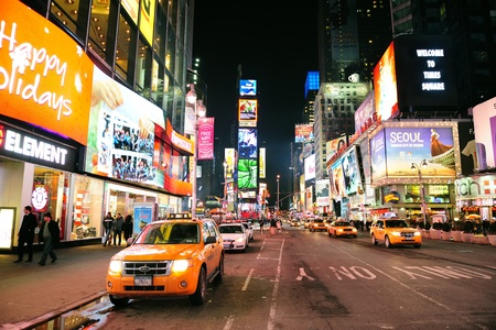 NEW YORK CITY, NY - JAN 30: Times Square is featured with Broadway Theaters and LED signs as a symbol of New York City and the United States. January 30, 2011 in Manhattan, New York City.  Stock Photo - 9444836