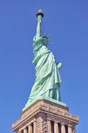 liberty island: Statue of Liberty on Liberty Island closeup with blue sky in New York City Manhattan Stock Photo