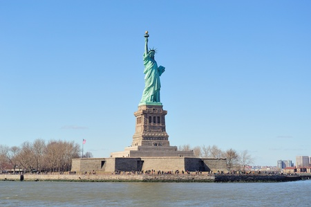liberty island: Statue of Liberty closeup on Liberty Island of New York City Manhattan with blue clear sky. Stock Photo