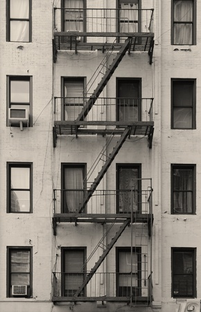 Stairway outside of old building in New York City Manhattan apartment in black and white.