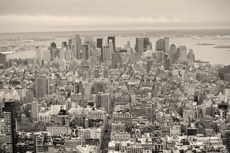 aerial view city: New York City Manhattan downtown aerial view with urban city skyline and skyscrapers buildings in black and white. Stock Photo