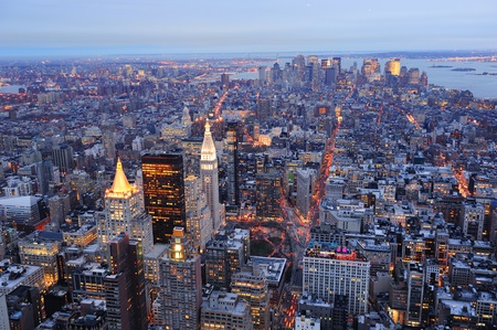 New York City Manhattan downtown aerial view at dusk with urban city skyline and skyscrapers buildings photo