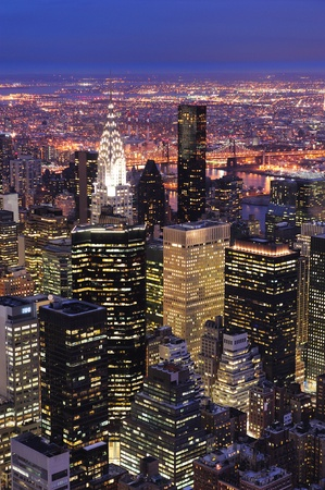penthouse: New York City Manhattan aerial view at dusk with urban city skyline and skyscrapers buildings