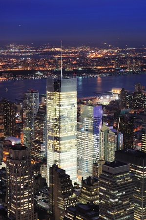 New York City Manhattan Times Square night city skyline aerial view with urban skyscraper illuminated. photo