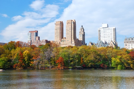 New York City Manhattan Central Park panorama in Autumn lake with skyscrapers and colorful trees with reflection. photo