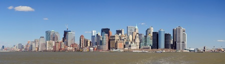 New York City Manhattan downtown skyline panorama view with Empire State Building and skyscrapers with blue clear sky over river photo