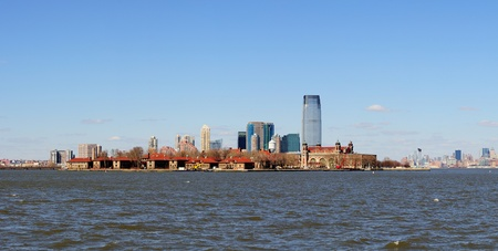 New Jersey Hoboken skyline panorama over Hudson River with skyscrapers and blue clear sky viewed from New York City Manhattan downtown. Stock Photo - 9479115