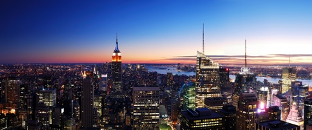 New York City Manhattan skyline panorama aerial view with Empire State Building and Times Square at sunset.