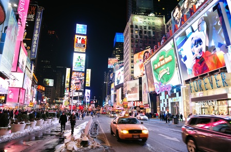 NEW YORK CITY, NY - JAN 30: Times Square is featured with Broadway Theaters and LED signs as a symbol of New York City and the United States. January 30, 2011 in Manhattan, New York City.  Stock Photo - 9475521