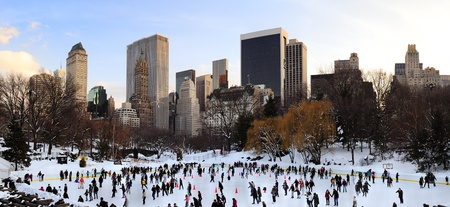 NEW YORK CITY, NY - JAN 1: People skate on ice with white Christmas in Central Park welcome the new year of 2010 on January 1, 2011 in Manhattan, New York City. Stock Photo - 9475525