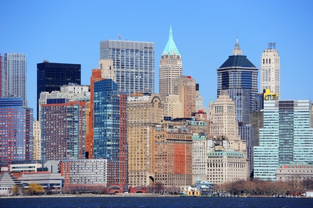 Skyscrapers of New York City Manhattan downtown with urban city skyline over Hudson River with blue clear sky Stock Photo - 9481056