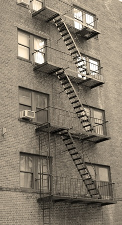 Stairway outside of old building in New York City Manhattan apartment in black and white. Stock Photo - 9480620