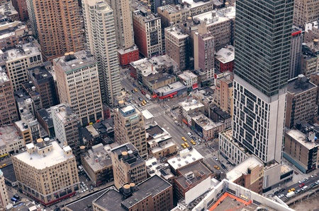 aerial city: New York City Manhattan street aerial view with skyscrapers, pedestrian and busy traffic. Stock Photo
