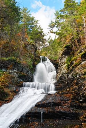 Waterfall in Autumn mountain with woods, foliage and rocks. From Digmans Fall of Pennsylvania photo