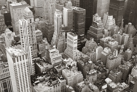 manhattan: New York City Manhattan skyline aerial view black and white with skyscrapers and street.
