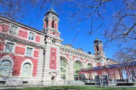 ellis: New York City Ellis Island Great Hall with blue clear sky