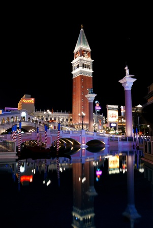LAS VEGAS, NEVADA - MARCH 3, Venetian and Mirage Hotel Casino with clock tower illuminated with colorful lights at night, March 3, 2010 in Las Vegas, Nevada.