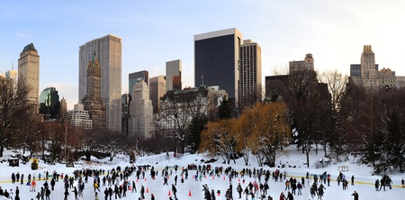 NEW YORK CITY, NY - JAN 1: People skate on ice with white Christmas in Central Park welcome the new year of 2010 on January 1, 2011 in Manhattan, New York City.