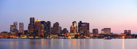 Boston downtown at dusk with urban buildings illuminated at dusk after sunset.  photo