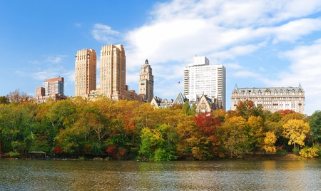 New York City Manhattan Central Park panorama in Autumn lake with skyscrapers and colorful trees over with reflection. photo