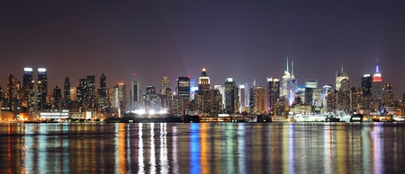 hudson river: New York City Manhattan midtown skyline at night with lights reflection over Hudson River viewed from New Jersey Weehawken waterfront. Stock Photo