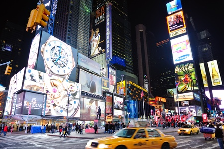NEW YORK CITY, NY - JAN 30: Times Square is featured with Broadway Theaters and LED signs as a symbol of New York City and the United States. January 30, 2011 in Manhattan, New York City.  Stock Photo - 10404954