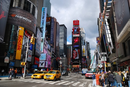 busy city: NEW YORK CITY - SEP 5: Times Square, featured with Broadway Theaters and LED signs, is a symbol of New York City and the United States, September 5, 2009 in Manhattan, New York City.