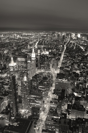 New York City Manhattan aerial view at dusk with urban city skyline and skyscrapers buildings black and white photo