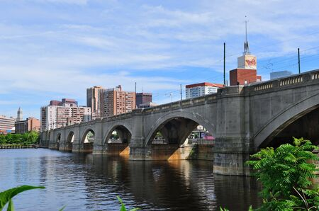 Boston skyline panorama over Charles River with bridge and urban architecture.