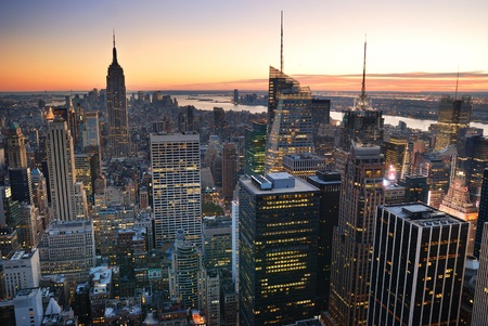New York City Manhattan skyline aerial view with Empire State Building and Times Square at sunset.