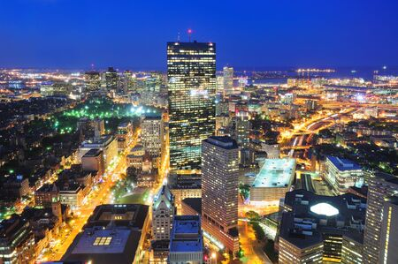 Boston aerial view with skyscrapers at dusk with city skyline illuminated. photo