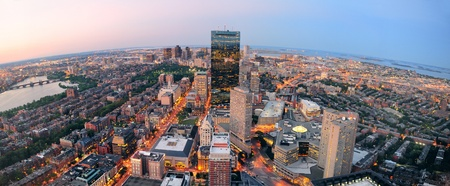 boston: Urban city aerial panorama view. Boston aerial view with skyscrapers at sunset with city downtown skyline.