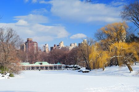New York City Manhattan Central Park panorama in winter with ice and snow over lake with skyscrapers and blue sunny sky at dusk. Stock Photo - 10603788