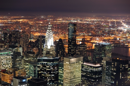 chrysler building: New York City Manhattan aerial view at dusk with urban city skyline and skyscrapers buildings