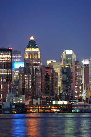 midtown: Urban modern architecture in New York City midtown Manhattan at dusk over river. Stock Photo