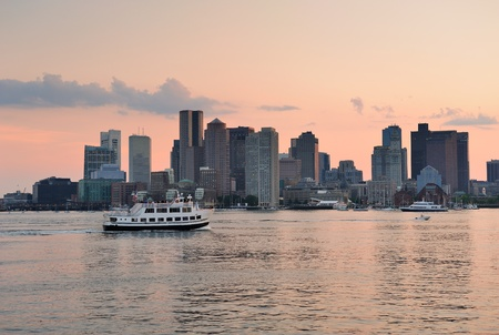 Boston downtown sunset skyline over river with skyscrapers and boat. Stock Photo - 10603822