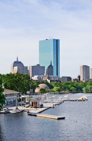 Boston back bay with sailing boat and urban building city skyline in the morning.  photo