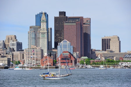 boston cityscape: Boston downtown urban architecture with boat and city skyline.