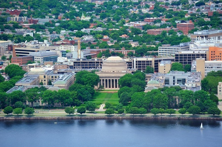 Boston Massachusetts Institute of Technology campus with trees and lawn aerial view with Charles River photo