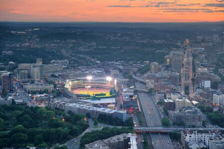baseball stadium: Boston aerial view at sunset with cityscape and buildings.