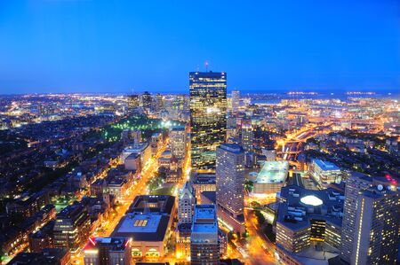boston cityscape: Boston aerial view with skyscrapers at dusk with city skyline illuminated.