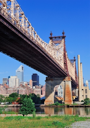east coast: Queensborough Bridge in Midtown Manhattan with New York City skyline over East River as the famous landmarks viewed from Brooklyn.