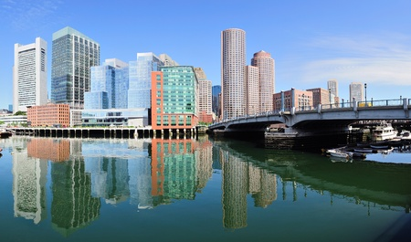 Boston waterfront panorama with skyscrapers and bridge in the morning.