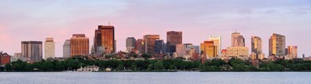 Boston Charles River sunset panorama with urban skyline and skyscrapers